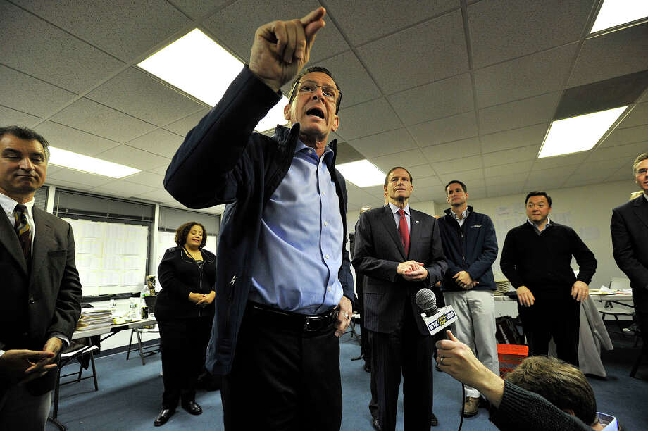Gov. Dannel P. Malloy addresses a crowd of Democratic supporters at Stamford Democratic Headquarters in Stamford, Conn., the evening before polls open in the state on Monday, Nov. 3, 2014. Photo: Jason Rearick / Stamford Advocate