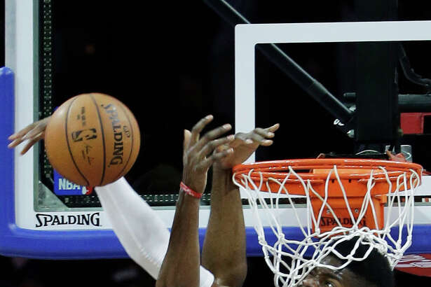 Philadelphia 76ers' Nerlens Noel, right, blocks a dunk by Houston Rockets' James Harden during the second half of an NBA basketball game, Monday, Nov. 3, 2014, in Philadelphia. Houston won 104-93. (AP Photo/Matt Slocum)