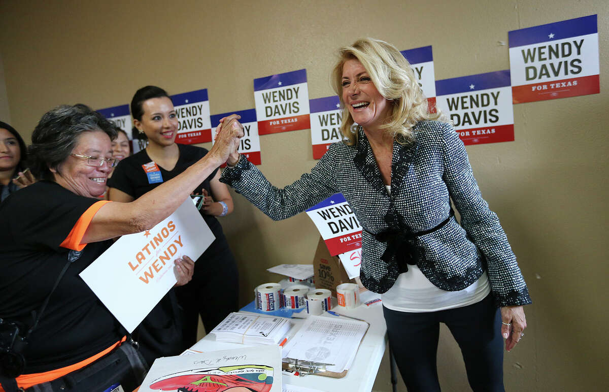 Democratic gubernatorial candidate Wendy Davis greets supporters as she does last-minute campaigning Monday in San Antonio.