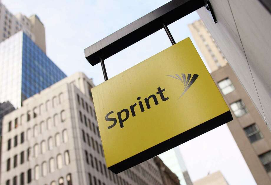 Sprint said Monday it suffered a net loss of $765 million, or 19 cents a share, in its second quarter  after posting a profit of $23 million a quarter ago.  Photo: DON EMMERT, Staff / AFP