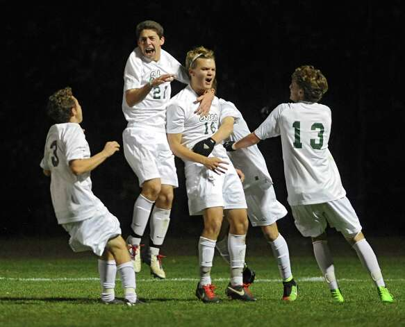 Shenendehowa's  James Homan, #16, center, celebrates after scoring the only goal of the game during the  Section II Class AA boys' soccer championship game against Niskayuna on Monday, Nov. 3, 2014 in Colonie, N.Y. (Lori Van Buren / Times Union) Photo: Lori Van Buren / 00029287A