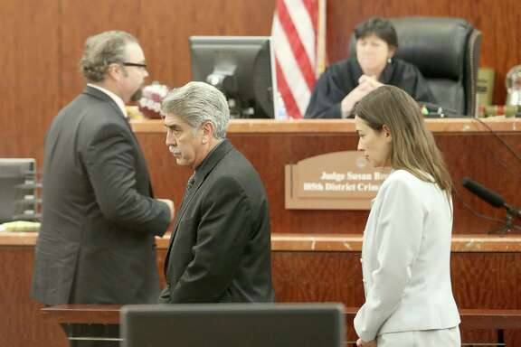 Constable Victor Trevino, center, admits that he took money for personal use from a charity he founded.