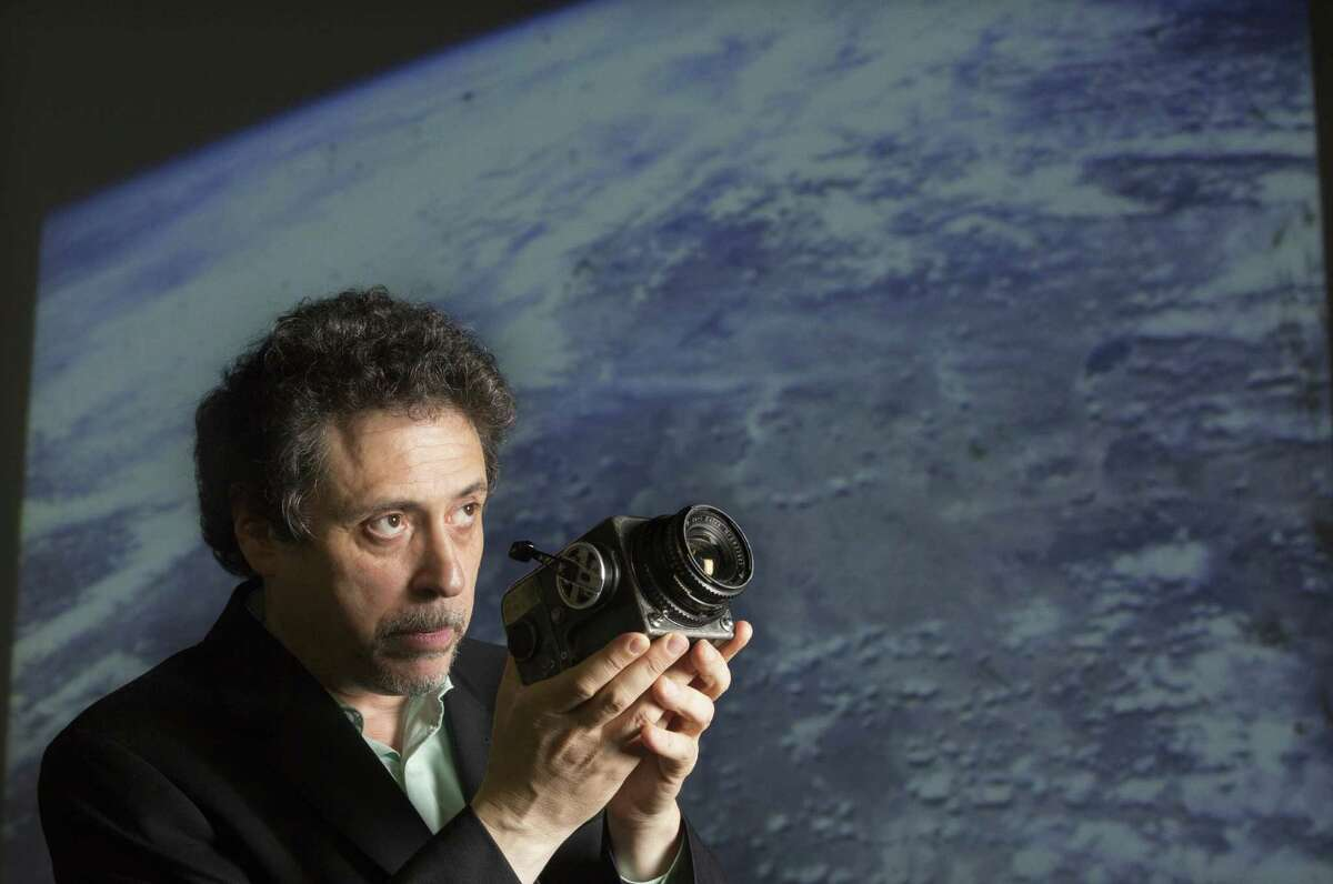 Bobby Livingston with RR Auction holds the first Hasselblad camera and Zeiss lens that NASA Capt. Walter Schirra used.