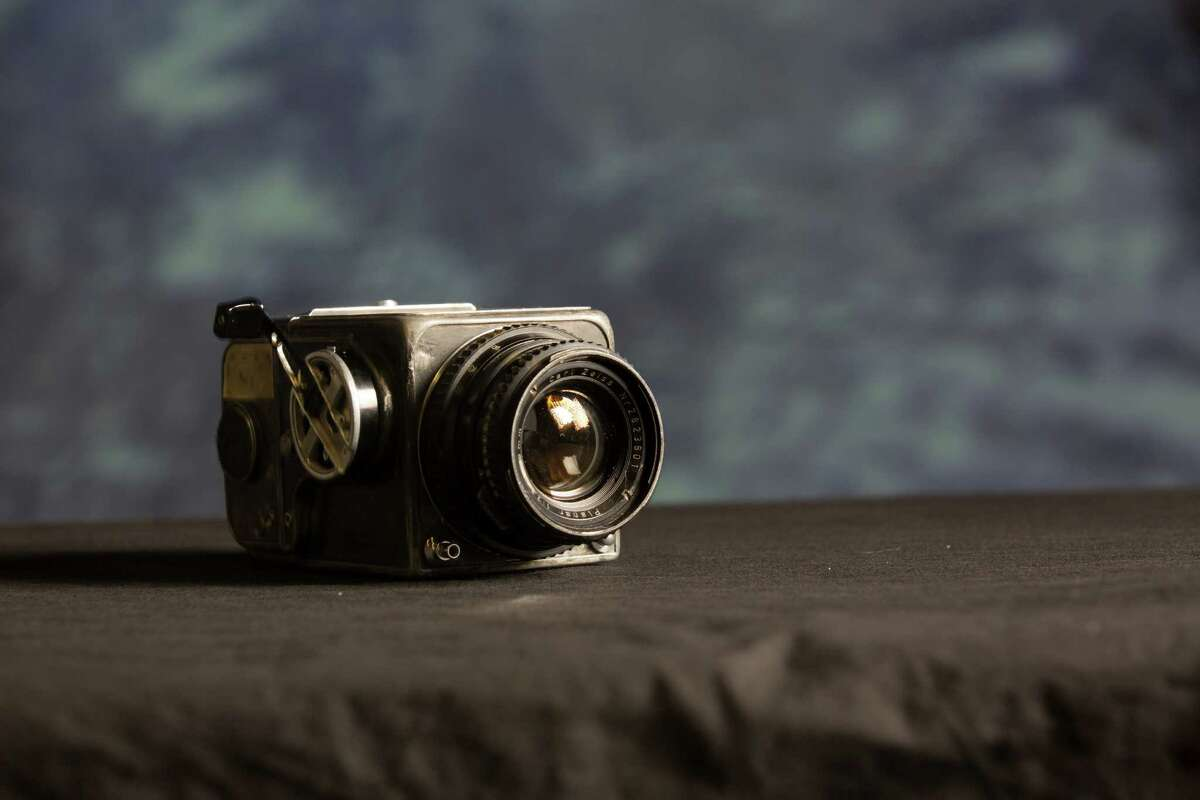 The first Hasselblad camera and Zeiss lens flown in space which NASA Capt. Walter Schirra used to take the first high quality images of Earth from space on the Mercury 8 mission, the lens and film magazine also flew with Gordon Cooper on Mercury 9 Monday, Oct. 20, 2014, in Houston. The camera will be auctioned off by RR Auction on November 13. ( Johnny Hanson / Houston Chronicle )