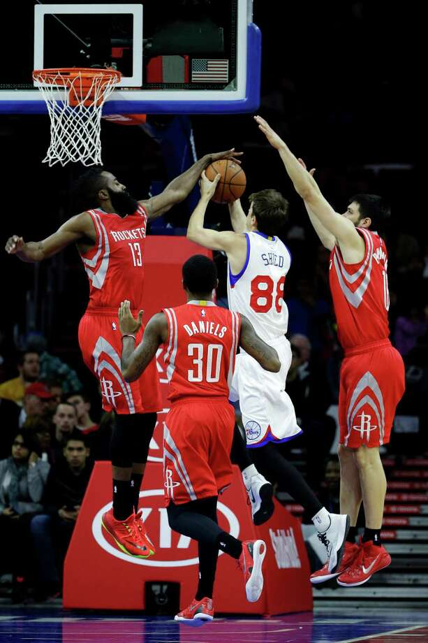 The 76ers' Alexey Shved (2-for-8) cannot get a shot past the Rockets' James Harden, left, Kostas Papanikolaou, right, and Troy Daniels in the first half. Photo: Matt Slocum, STF / AP