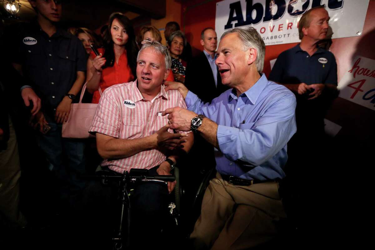 Republican Greg Abbott visits Greg Laconis of Houston during a campaign stop at a restaurant in that city. Abbott urged the GOP faithful to vote today, warning them against thinking that