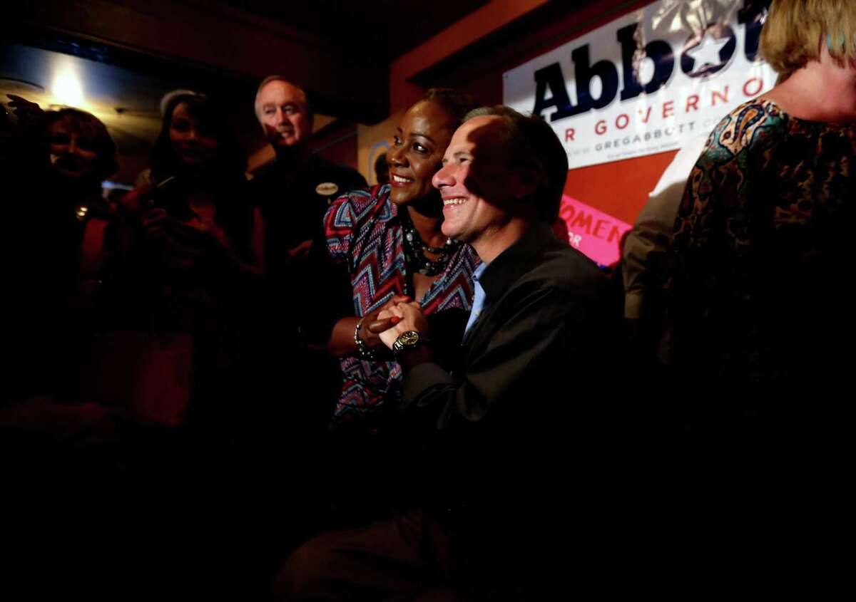 A constituent takes a photo with Republican candidate for Texas Gov. Greg Abbott on the last day of campaigning at Molina's Cantina Monday, Nov. 3, 2014, in Houston, Texas. ( Gary Coronado / Houston Chronicle )