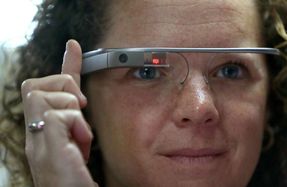 Memorial Hermann hospital has begun using Google Glass on its UTHealth Mobile Stroke Unit Monday, Nov. 3, 2014, in Houston, Texas. Stephanie Parker, lead nurse, demonstrates the use of Google Glass and how it is used to communicate with a Telemedicine physician on call. Photo: Gary Coronado, Houston Chronicle / © 2014 Houston Chronicle