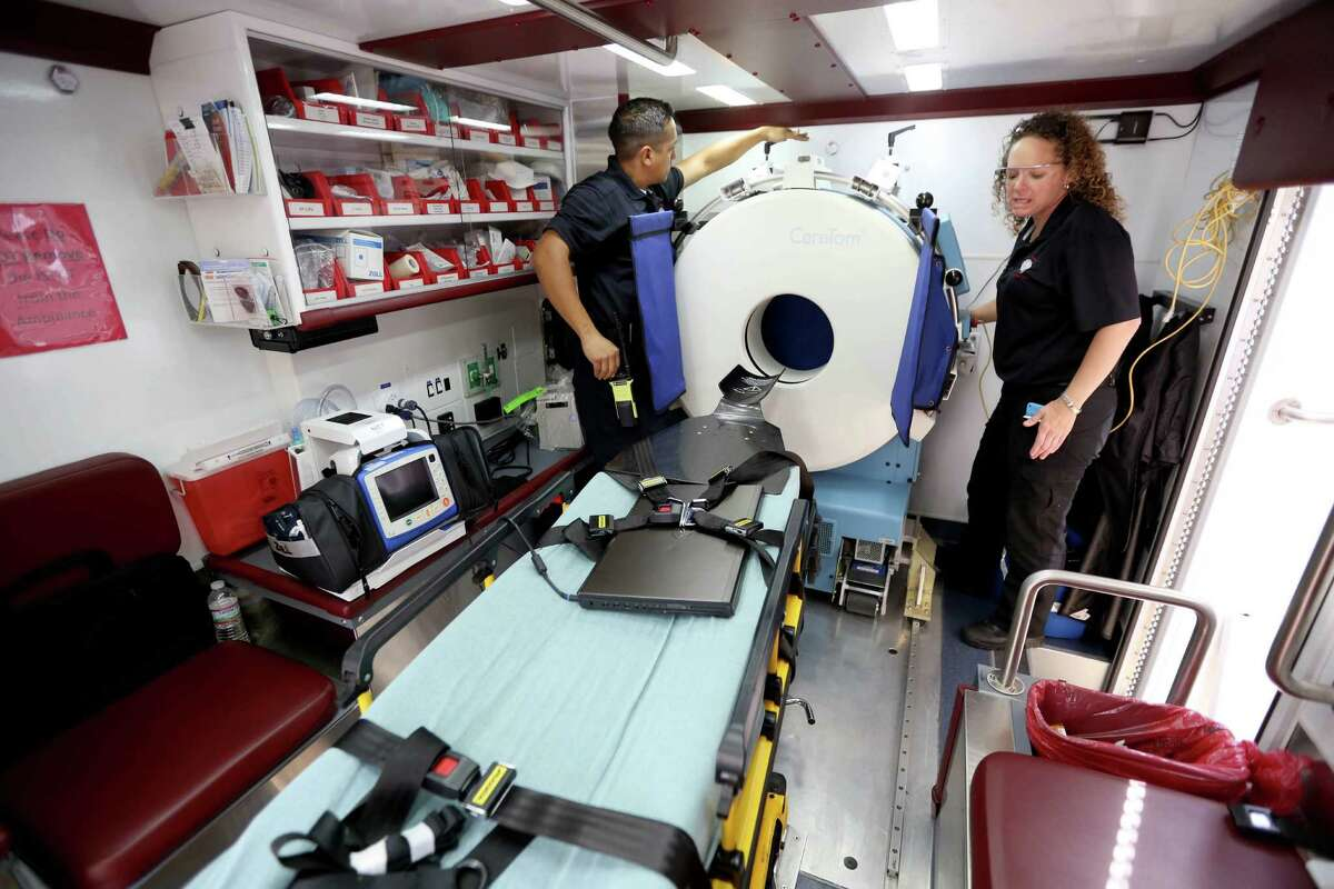 Memorial Hermann hospital has begun using Google Glass on its UTHealth Mobile Stroke Unit Monday, Nov. 3, 2014, in Houston, Texas. Rick Campos, registered nurse and paramedic, left, along with Stephanie Parker, lead nurse, demonstrate the portable CT machine aboard the mobile unit.