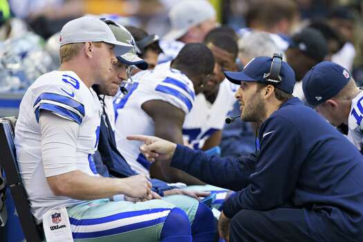 Tony Romo talks with Brandon Weeden of the Dallas Cowboys on the sidelines during the second quarter of a game against the Arizona Cardinals at AT&T Stadium on Nov. 2. Photo: Wesley Hitt / Wesley Hitt / Getty Images / 2014 Getty Images