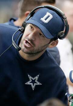 Injured Dallas Cowboys quarterback Tony Romo talks on the sideline during the second half against the Arizona Cardinals on Nov. 2. Photo: Brandon Wade / Brandon Wade / Associated Press / FR168019 AP