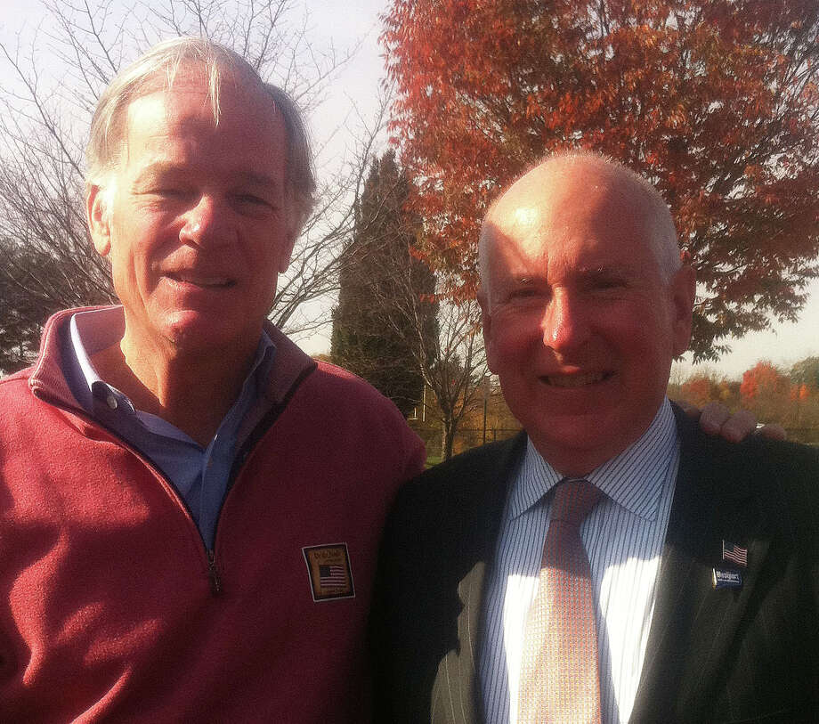 Tom Foley, left, the Republican candidate for governor, stopped to greet voters outside the Saugatuck School polls Tuesday morning. He was greeted there by First Selectman Jim Marpe. Photo: Anne M. Amato / Westport News