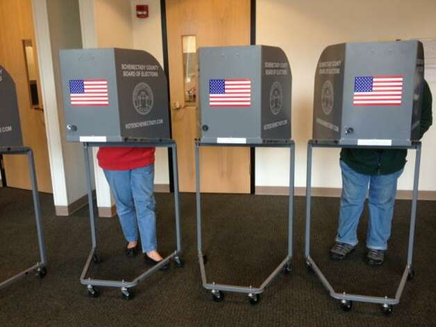 Voters fill out their ballots at the Jewish Community Center in Niskayuna, NY, on Tuesday, Nov. 4, 2014. (Cindy Schultz/Times Union)