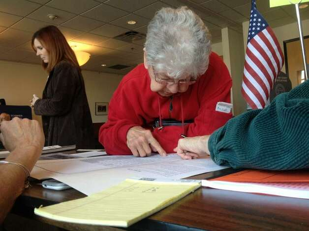 A voter reviews the propositions on the ballot at the Jewish Community Center in Niskayuna, NY, on Election Day, Nov. 4, 2014. (Cindy Schultz/Times Union)