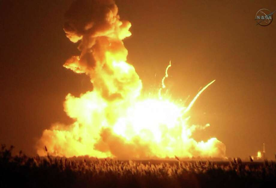 An unmanned rocket explodes at Wallops Island, Virginia, seconds after a Oct. 28 liftoff. Some 5,000 pounds of experiments and equipment for the International Space Station was destroyed. Photo: NASA TV / Associated Press / NASA TV