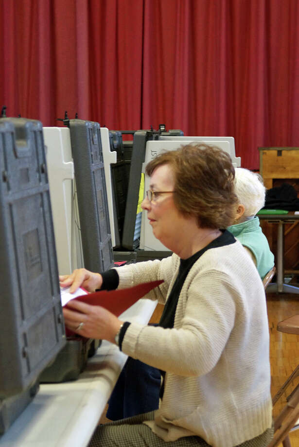 Voter turnout was steady, and running a bit higher than usual, at Sherman School in District 10, according to moderators. Photo: Genevieve Reilly / Fairfield Citizen