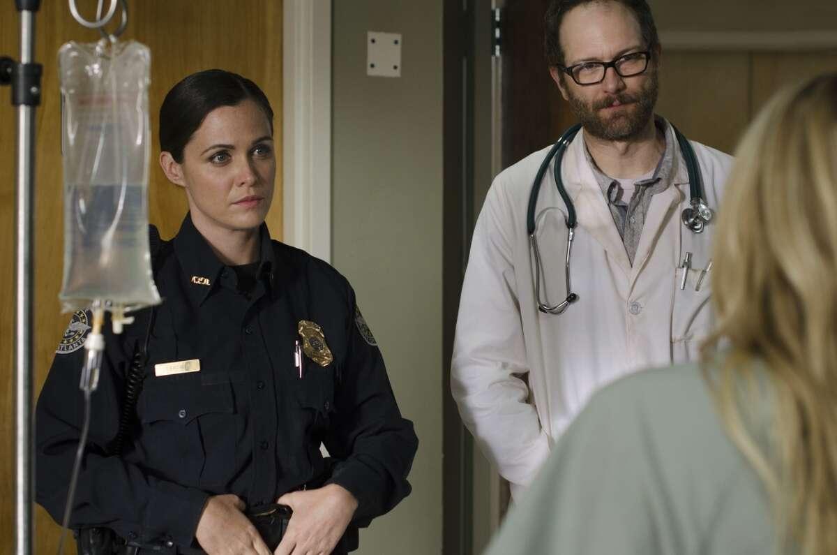 Erik Jensen as Dr. Edwards and Christine Woods as Officer Dawn Lerner - The Walking Dead _ Season 5, Episode 4 - Photo Credit: Gene Page/AMC