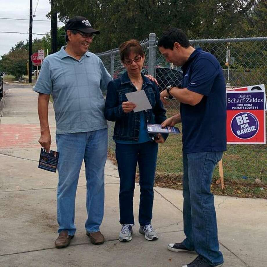 Trey Martinez Fischer has no opponent but he spent part of the morning talking to voters outside Woodlawn Elementary. Photo: John Tedesco/San Antonio Express-News