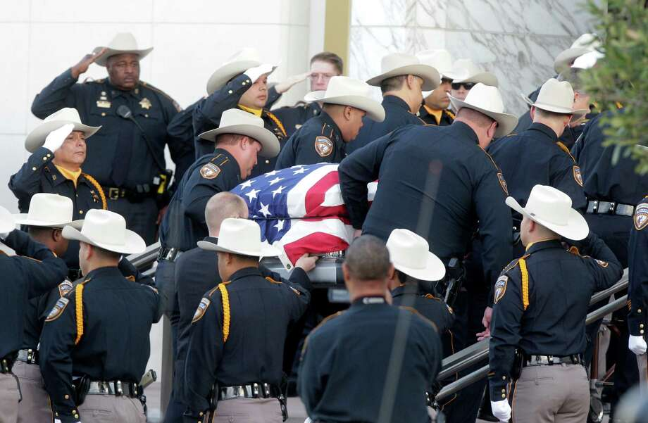 "Sheriff's Deputies carry the fallen Sheriff's Office Deputy Jesse ""Trey"" Valdez III into the Co-Cathedral of the Sacred Heart for the funeral mass on Tuesday, Nov. 4, 2014, in Houston. Photo: Mayra Beltran, Houston Chronicle / © 2014 Houston Chronicle"
