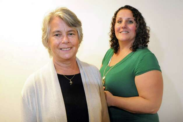 Sarah Hafensteiner of Coeymans, center, and Rebecca Burch of Troy, both who have had breast reconstruction surgery, on Wednesday, Oct. 15, 2014, at Albany Medical Center in Albany, N.Y. (Cindy Schultz / Times Union) Photo: Cindy Schultz / 10028933A