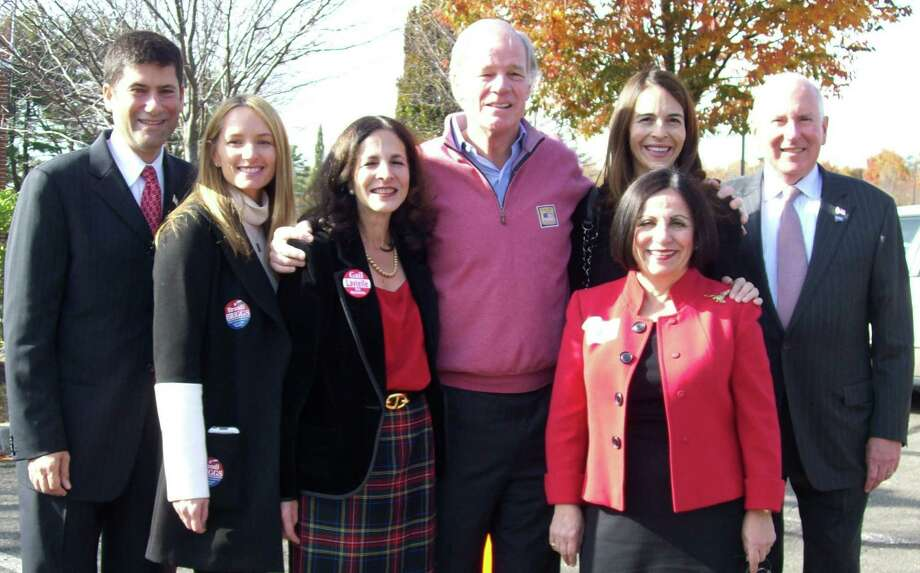 Tom Foley (center), the Republican gubernatorial candidate, stopped at the District 1 polls at Saugatuck Elementary School Tuesday morning where he was greeted by local Republicans. Also pictured are: (from left) Selectman Avi Kaner; Brandi Briggs, who is running for state representative in the 136th District;  incumbent state Rep. Gail Lavielle, 143rd District; Foley; Foley's wife, Leslie; incumbent state Sen. Toni Boucher, 26th District (in front of Leslie Foley) and First Selectman Jim Marpe. Photo: Anne M. Amato / westport news