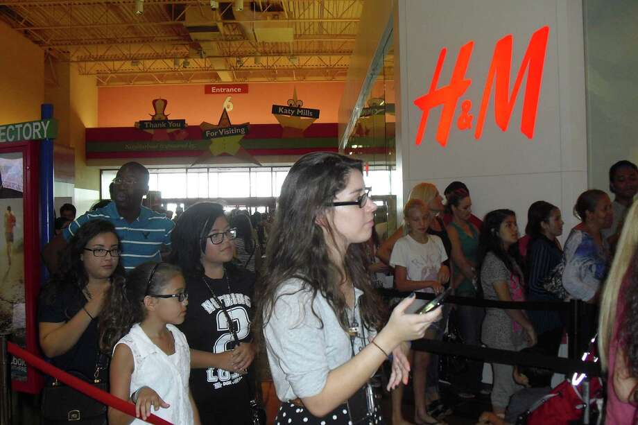 Hundreds lined up for the opening of H&M at Katy Mills mall last year. The retailer is planning to open a store in Pearland in the fall, which will be the fifth in the Houston market., including one at Baybrook Mall. Photo: Karen Zurawski
