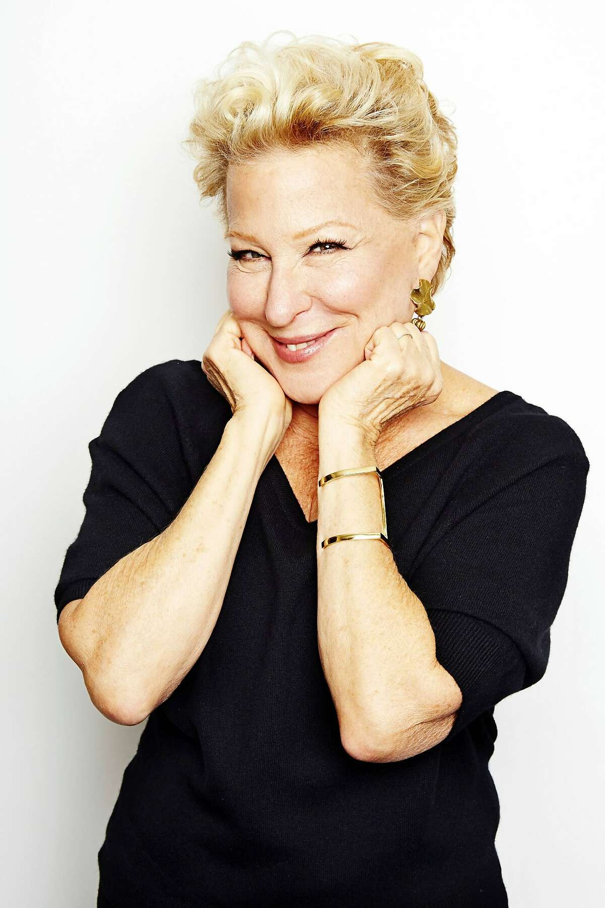 """In this Oct. 7, 2014 photo, entertainer Bette Midler poses for a portrait in promotion of her upcoming album """"It's the Girls!"""" in New York. The album is an eclectic collection of covers of 15 famous songs by seven decades of girl groups, from The Andrews Sisters to TLC. It's also Midler's 25th album and first studio offering in eight years. (Photo by Dan Hallman/Invision/AP)"""
