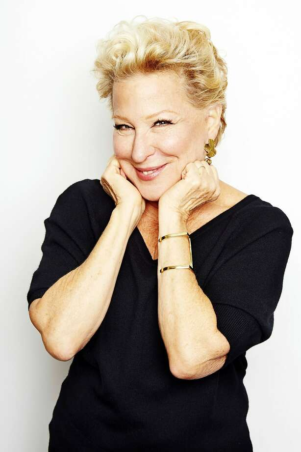 "In this Oct. 7, 2014 photo, entertainer Bette Midler poses for a portrait in promotion of her upcoming album ""It's the Girls!"" in New York. The album is an eclectic collection of covers of 15 famous songs by seven decades of girl groups, from The Andrews Sisters to TLC. It's also Midler's 25th album and first studio offering in eight years. (Photo by Dan Hallman/Invision/AP) Photo: Dan Hallman, Associated Press"