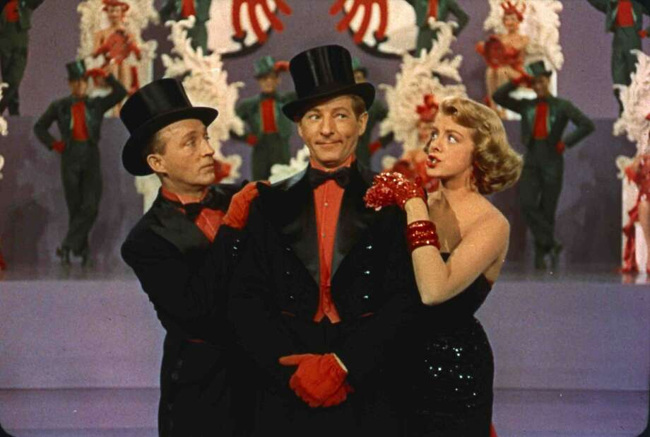 "Bing Crosby (left), Danny Kaye and Rosemary Clooney in ""White Christmas."" Photo: Paramount Pictures 1954"