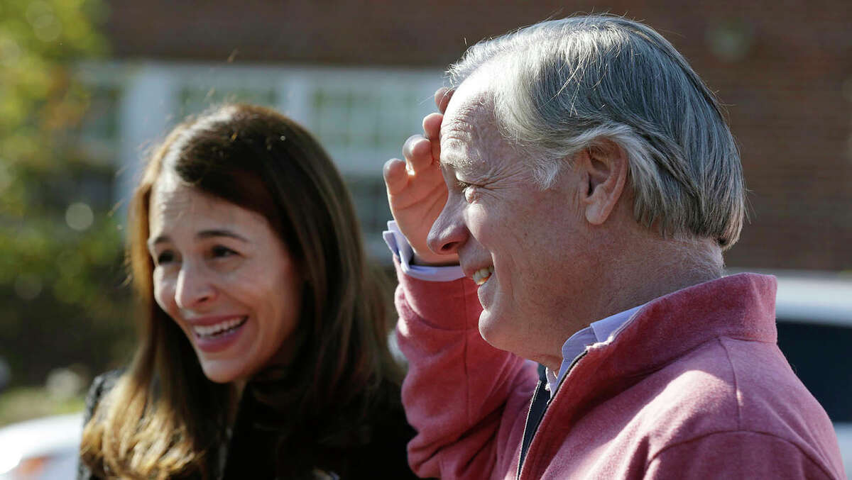 Republican candidate for governor Tom Foley, and his wife Leslie, talk with residents heading to vote while campaigning outside a polling place in Westport, Conn., Tuesday, Nov. 4, 2014. Foley is facing incumbent Democratic Gov. Dannel Malloy in the general election. (AP Photo/Charles Krupa)