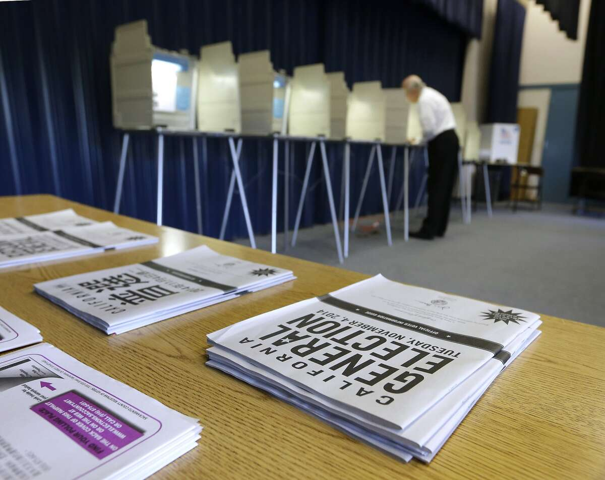 A voter marks his ballot while voting in Elk Grove, Calif. Tuesday, Nov. 4, 2014.