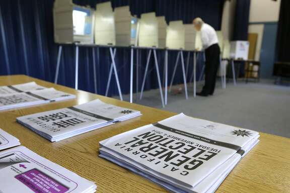 A voter marks his ballot while voting in Elk Grove, Calif. Tuesday, Nov. 4, 2014.  Voter turnout is expected to be low this election year.