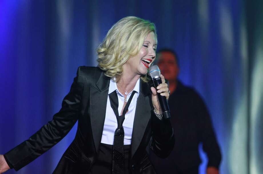 Olivia Newton-John is shown performing in Stafford, Texas, in 2014. Photo: Gary Fountain, Freelance / Copyright 2012 Gary Fountain.