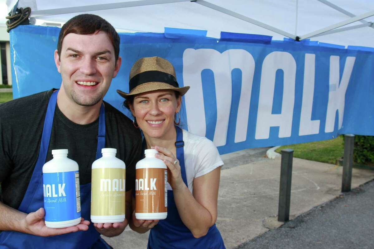 Justin Brodnax and August Vega peddle Malk, including unsweetened almond, vanilla almond and maple pecan flavors, at the Urban Harvest Farmers Market.