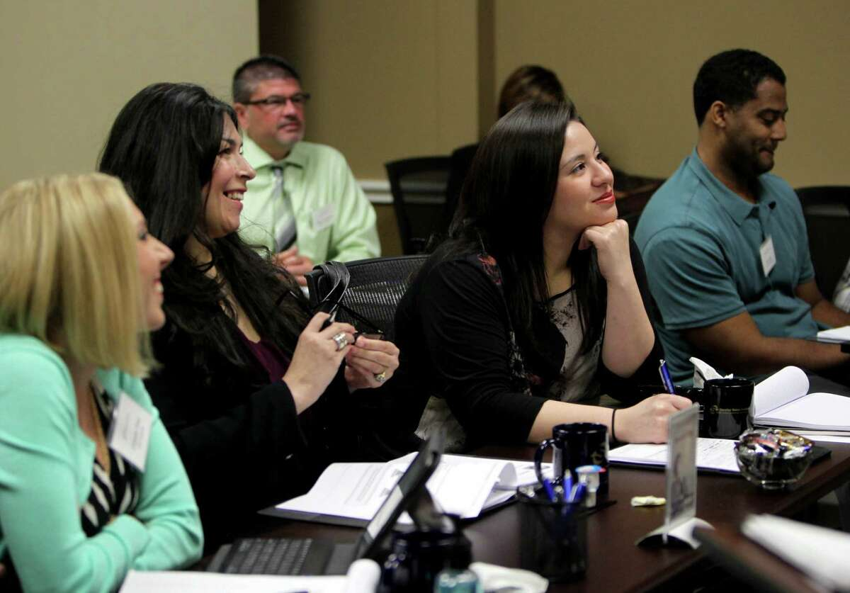 Katherine Benites, second from right, of SSD Financial Marketing, along with other classmates, at a training session conducted by Brad Freyer, managing partner, at Sandler Training, professional sales & management training Monday, Oct. 6, 2014, in Houston, Texas.