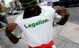 An activist in Washington, D.C., makes his allegiance clear on election day. A measure legalizing the use of marijuana passed in the nation's capital.