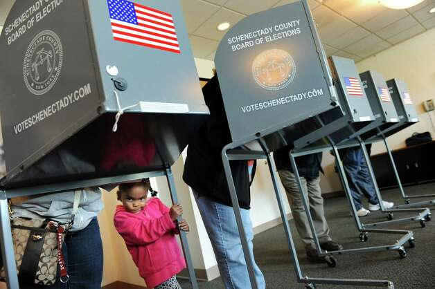 Olivia Benson, 4, waits as her mother, Annette Benson, votes on Election Day on Tuesday, Nov. 4, 2014, at the Jewish Community Center in Niskayuna, N.Y. (Cindy Schultz / Times Union) Photo: Cindy Schultz / 00029313A