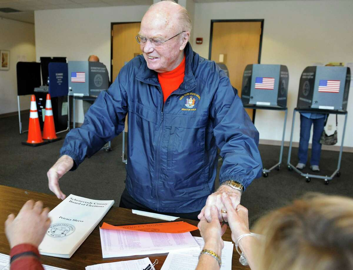 Sen. Hugh Farley greets election workers before casting his vote on Election Day on Tuesday, Nov. 4, 2014, at the Jewish Community Center in Niskayuna, N.Y. (Cindy Schultz / Times Union)