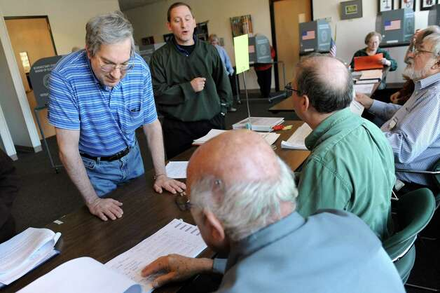 Mark Palatsky, left, prepares to vote on Election Day on Tuesday, Nov. 4, 2014, at the Jewish Community Center in Niskayuna, N.Y. (Cindy Schultz / Times Union) Photo: Cindy Schultz / 00029313A