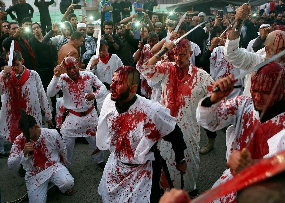 Iraqi Shiite faithful worshippers cut themselves with swords and knives to show their grief during the holy day of Ashoura in Basra, 340 miles (550 kilometers) southeast of Baghdad, Iraq, Tuesday, Nov. 4, 2014. Shiites mark Ashoura, the tenth day of the month of Muharram, to commemorate the Battle of Karbala when Imam Hussein, a grandson of Prophet Muhammad, was killed. Photo: Nabil Al-Jurani, Associated Press