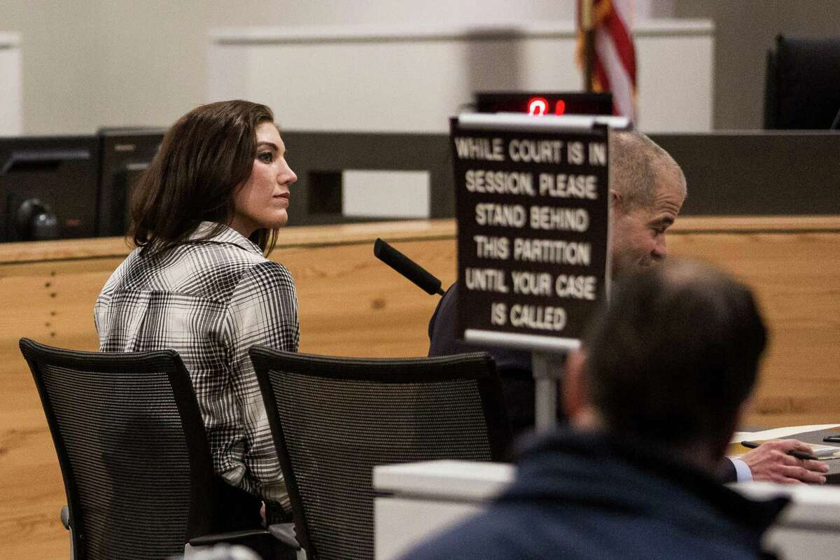 U.S. soccer star and UW graduate, Hope Solo, also known as Hope Stevens, appears at the Kirkland Municipal Court Tuesday, Nov. 4, 2014, in Kirkland, Wash. Hope Solo pleaded not guilty in a domestic violence case in mid-June. This was her third appearance in court, with a pending trial date on Jan. 20, 2015.