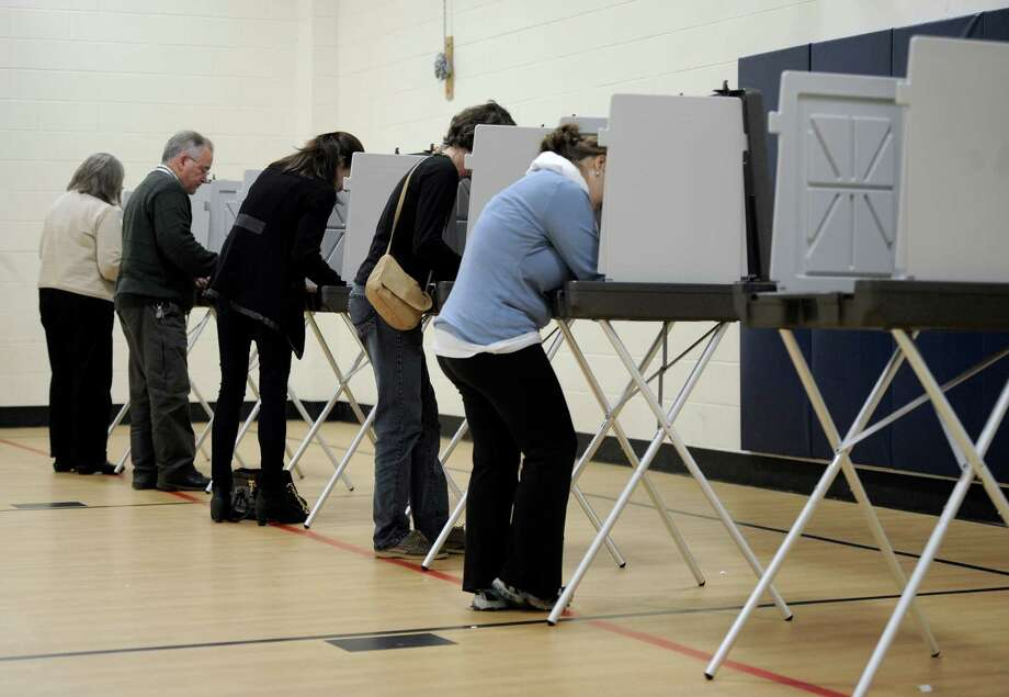 Voting at Huckleberry Hill Elementary School, on Tuesday, November 4, 2014, in Brookfield, Conn. Photo: H John Voorhees III / The News-Times