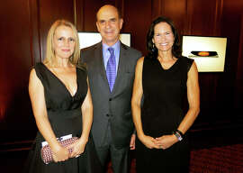 Heather Ive (left) with SFMOMA board President Bob Fisher and his wife, Randi.