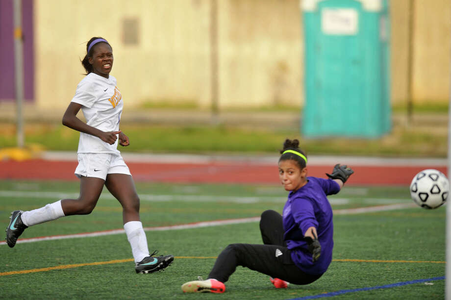 Westhill's Chelsea Domond shoots and scores on NFA goalie Kayla Tosses in the remaining seconds of their Class LL state tournament game at Westhill High School in Stamford, Conn., on Tuesday, Nov. 4, 2014. Westhill won, 6-0. Photo: Jason Rearick / Stamford Advocate
