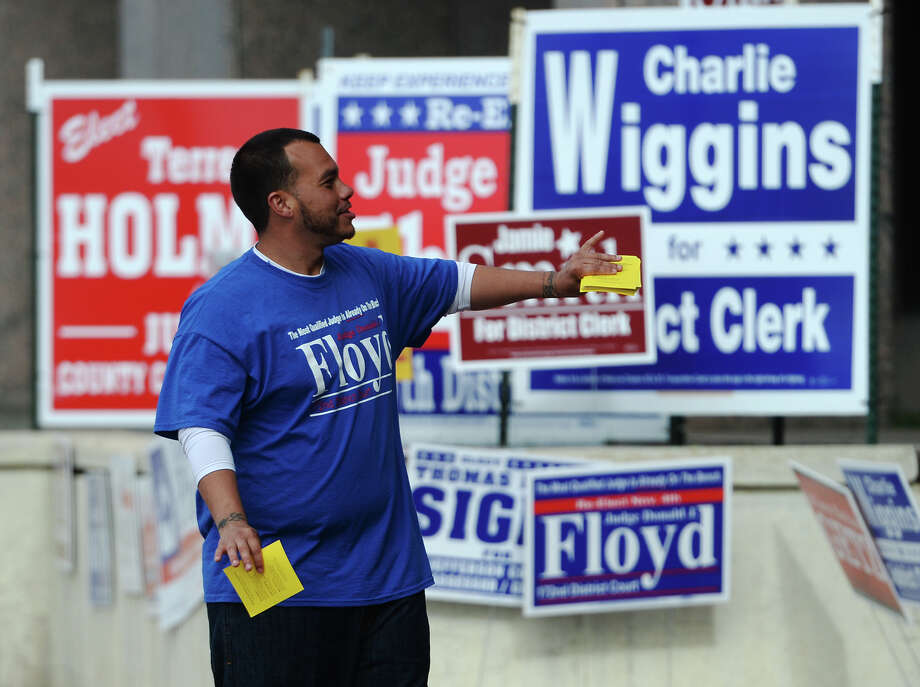 Benjamin Cooper, a volunteer, campaigns for Judge Donald Floyd outside the Jefferson County Courthouse on Monday morning.
