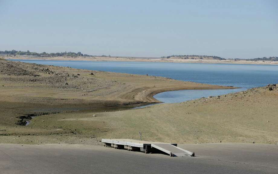 A dock sits high and dry at the end of a boat ramp at Folsom Lake, which has been hit hard by the California drought. Photo: Rich Pedroncelli / Associated Press / AP