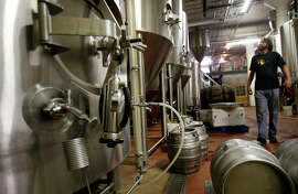 The final stop for the craft beer at Magnolia Brewing Co. in the Dogpatch area of S.F. is adding more carbonation. Below: Magnolia's Proving Ground IPA is a popular choice. Craft beer is one of the city's fastest-growing industries.