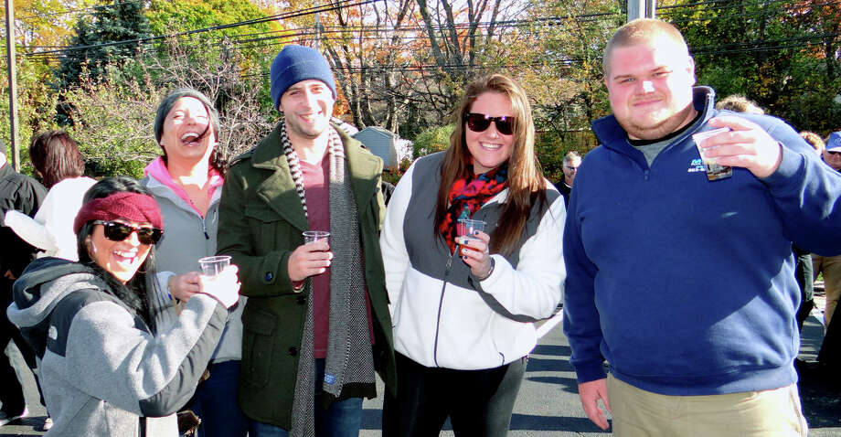 Erika McGuire, Nicole Homkovics, Andrew Perille, Julia Goodrich and Rich Wigglesworth enjoy Craft 260 Beer Bar/Bistro's Brewfest on Sunday afternoon. Photo: Mike Lauterborn / Fairfield Citizen
