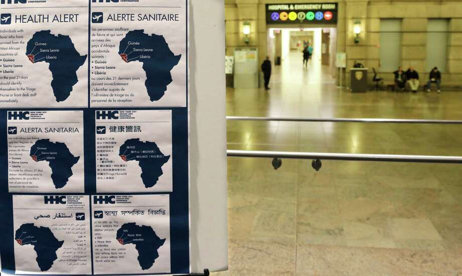 Health alerts regarding people who may have traveled to West African countries are posted in the lobby of Bellevue Hospital in New York. A reader advises Americans to maintain perspective, saying there are greater menaces than Ebola in this country. Photo: Mark Lennihan / Mark Lennihan / Associated Press / AP