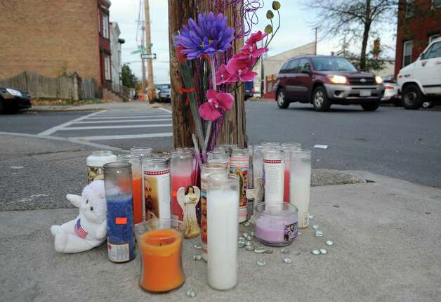A memorial set up outside of the 139 Quail St. at the corner of Benson Street on Tuesday Nov. 4, 2014 in Albany, N.Y. Desmond Wyatt was charged with second-degree murder for stabbing his mother, Beverly Wyatt, to death on Monday afternoon at her Quail Street home. (Michael P. Farrell/Times Union) Photo: Michael P. Farrell / 00029351A
